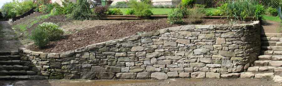 Dry stone retaining wall highland stonecraft for Stone retaining wall design