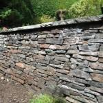 Base retaining wall