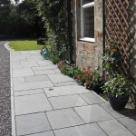 Limestone paving with granite edge