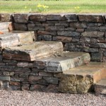 Random image: Flat stone steps built into retaining wall
