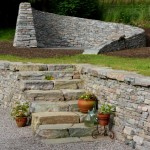 Generous stone steps provide a focal point and access between levels.
